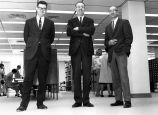 Student Publications - three men standing in library