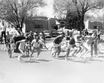 Student Publications - fraternities - men pulling chariots