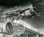 Steam Locomotive on crane atAtchison, Topeka and Santa Fe Railway shops, Albuquerque, New Mexico...