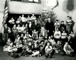 Clyde Tingley and group of orphan boys receiveng Christmas presents