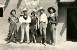Clyde Tingley with unidentified people in western wear
