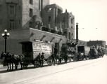 Springer Transfer Company freight wagons in front of Franciscan Hotel