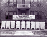 C.S. Hoit Fine Furniture advertising photograph in front of Victoria Terrace Apartments, 1410 East...