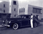 Buick automobile at UNM with unidentified young man, Albuquerque