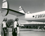 Albuquerque Municipal Airport, Native-American women stand below TWA   Lockheed Constellation