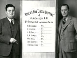 Oden Buick salesmen with sales quota poster, 312-320 North Fourth Street, Albuquerque
