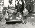Clyde Tingley, New Mexico Governor in front of governor's mansion, Santa Fe