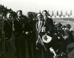 Clyde Tingley with four young men wearing varsity jackets, University of New Mexico, Albuquerque