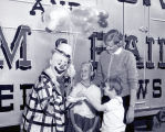 Barnum and Bailey Circus clown with mother and children, Albuquerque