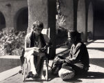 Alvarado Hotel veranda with guest and Native American vendor, Albuquerque