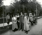 Group in front of automobile including Mrs. Miles Strumquist, Edmund  Cobb and Olive Hines,...