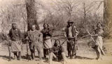 Indian agent posed with unidentified group in woods, Fraley, New Mexico