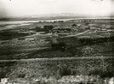 Birds-eye view of Santa Clara Pueblo, Rio Grande River in background, Denver Rio Grande Railroad...