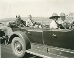 Governor Richard Dillon (second from left) riding in automobile procession, New Mexico