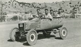 Men in decorated jalopy for parade float, Madrid ball park, New Mexico