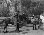 Cowboys gathered for a smoke, Brush Ranch, New Mexico