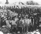 Young men being inducted into the Navy in front of the Palace of the Governors during Fiesta,...