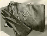 Zia symbol on ladies handbag and gloves, New Mexico