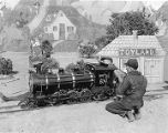 Man working on miniature train for Christmas events, Madrid, New Mexico