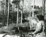 Woman painting in aspen grove, northern New Mexico