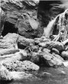 Young boy fishing at Jemez Falls, northern New Mexico