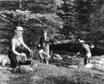 Family preparing a fish-fry beside northern New Mexico trout stream