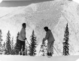 Skiers at the crest of Taos Ski Area, 19 miles northeast of Taos, New Mexico