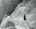Photographer on trail to Ceremonial Cave in Frijoles Canyon, Bandelier National Monument, New...