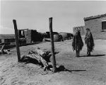Two women walking near the old mission church, Zuni Pueblo, New Mexico