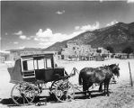 Taos Stage wagon and horses in front of Taos Pueblo, New Mexico