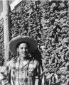 Young man posing with chili ristras, New Mexico