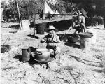 Young boy helping out with camp cooking, New Mexico