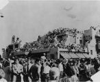 Crowds lining the street and roof of La Fonda Hotel during Fiesta, Santa Fe, New Mexico
