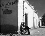 Man sitting outside La Posta, Mesilla, New Mexico