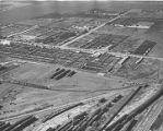 Aerial view of the vast stock yards and railroad loading tracks, Clovis, New Mexico