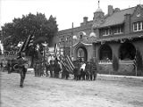 Unidentified parade in front of Elks Theater, Lincoln Avenue, Santa Fe, New Mexico