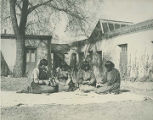 Maria Martinez (left) and others making pottery, Palace of the Governors courtyard, Santa Fe, New...