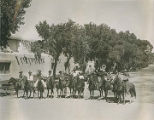 Group of horseback riders on Lincoln Avenue, Santa Fe, New Mexico