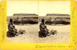 Man by pond with Acoma Pueblo mesa in background, New Mexico