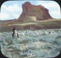 Navajo with flock of sheep, Toad Rock, Canyon de Chelly, Arizona