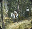 Mr. and Mrs. C.J. Birchfield horseback riding in aspen forest, Arizona