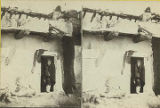 Pueblo woman in home doorway, New Mexico