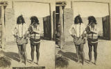 Two unidentified Indian men, one playing flute, New Mexico