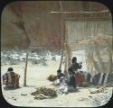 Navajo weaver in camp, Canyon de Chelly, Arizona