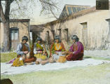 Group of Pueblo women potters in courtyard of Palace of the Governors, Santa Fe, New Mexico