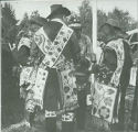 Group of men in costume showing woven bead ornaments, Menomini