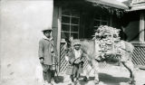 Woodvendors children with burro in front of Hudelson home, Santa Fe, New Mexico