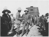 Pancho Villa in crowd by railroad boxcar, Mexico