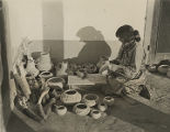Woman working on pottery, San Ildefonso Pueblo, New Mexico
