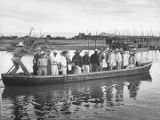 Group of men crossing the Santiago River, New Mexico